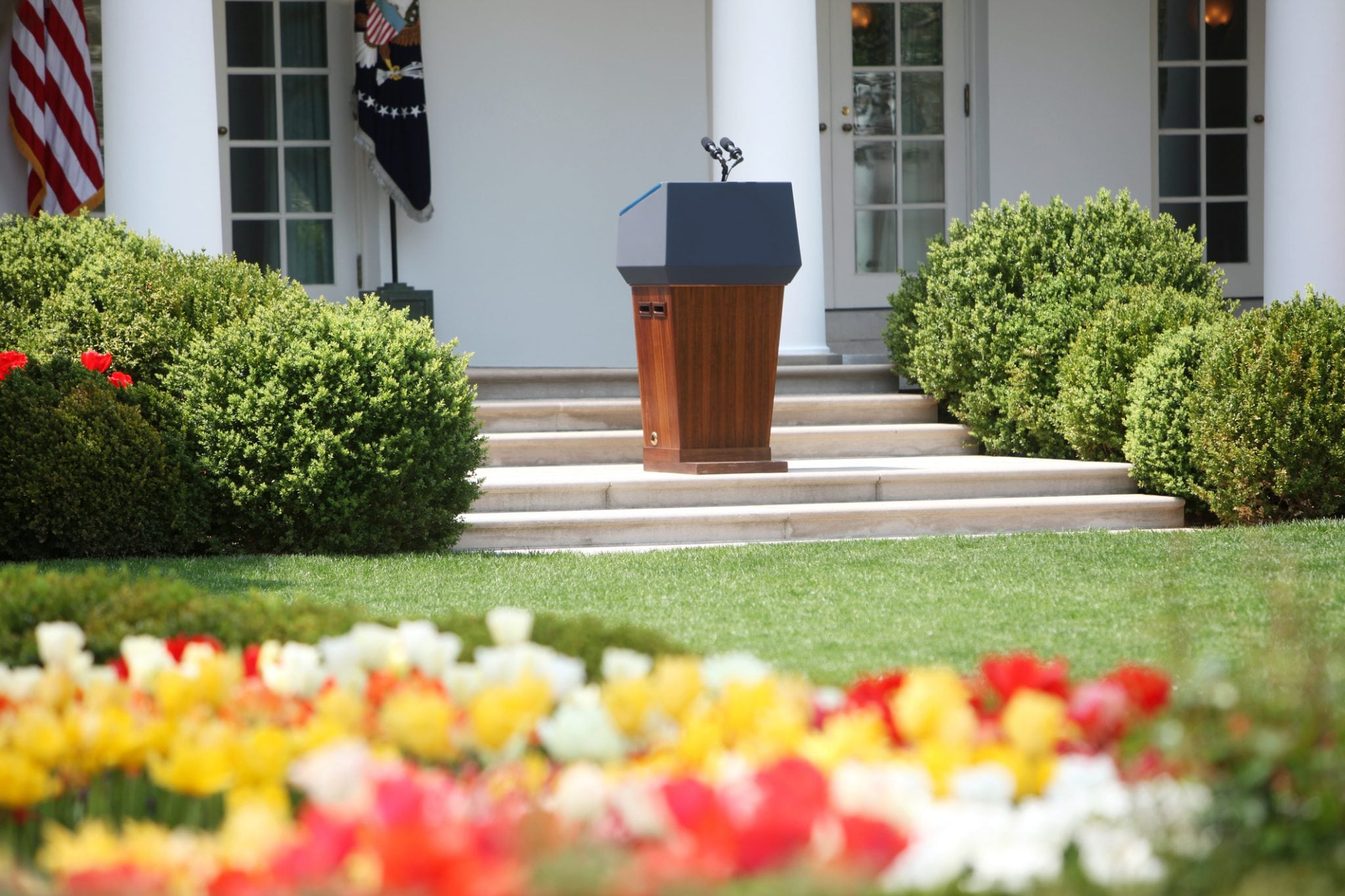 A Landscape Of The White House With Flowers And Bushes National